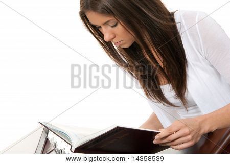 Woman Student Reading And Studying Book