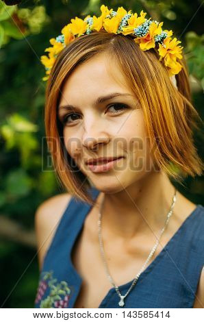 Portrait Of A Beautiful Young Woman Wearing Wreath. Young Beautiful Woman Posing With Flowers Bouque