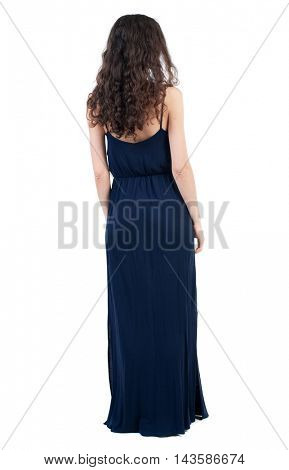 back view of standing young beautiful  woman.  girl  watching. Rear view people collection.  backside view of person. Curly dark girl is back in an evening dress.