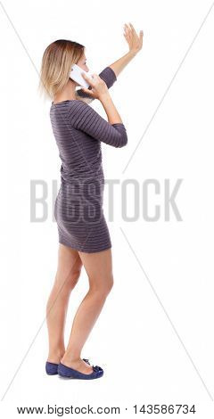 side view of a woman walking with a mobile phone. back view ofgirl in motion.  backside view of person.  Rear view people collection. Isolated over white background. Blonde in violet short dress