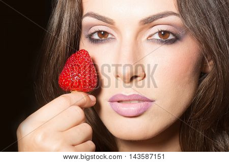 Sexy Woman Holding Red Strawberry