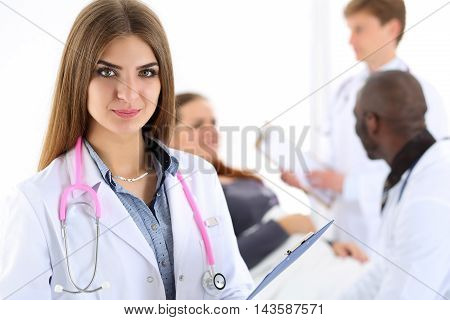 Beautiful Smiling Female Doctor Hold In Hand Clipboard Pad