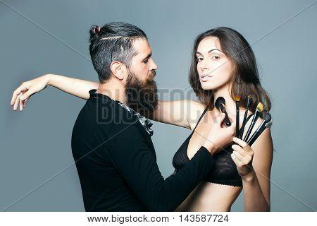 Visagiste Bearded Man And Sexy Woman