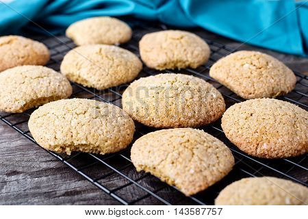 Ginger soft cookies - homemade brown cookies on wood background