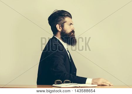 Bearded Man Teacher At Table
