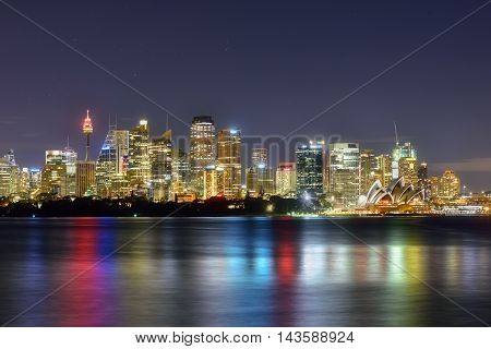 SYDNEY AUSTRALIA - August 212016: View Sydney CBD and The Opera House on sunset Sydney Australia Over 10 millions tourists visit Sydney every year