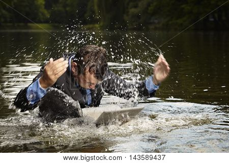 Crazy businessman in suit swimming in water