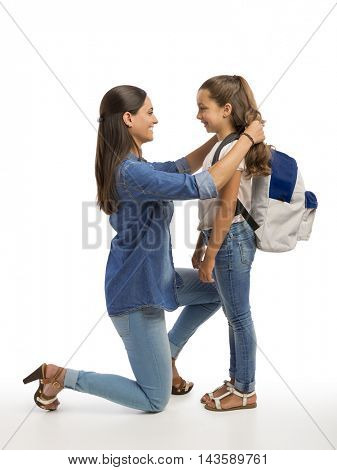 Mother comforting her daughter on the first day of school
