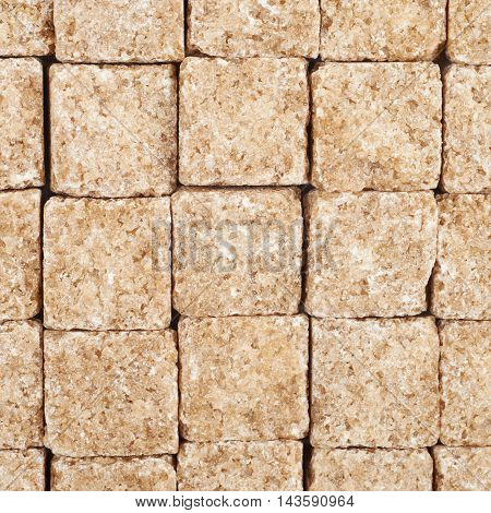 Surface coated with the multiple brown sugar cubes as a backdrop texture composition