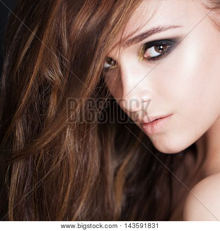 Curly dark brown Hair Woman. Face Closeup