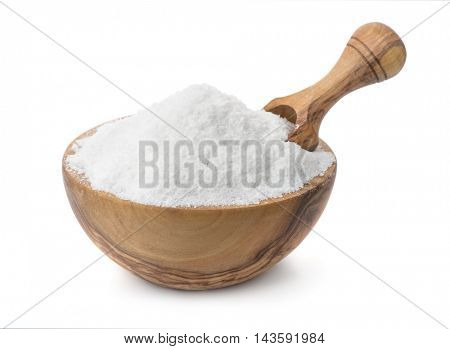 Wood bowl full of cooking salt with scoop isolated on white