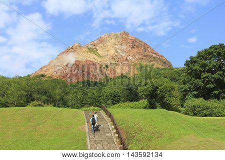 HOKKAIDO JAPAN - AUGUST 28 2015 : View of Usu-zan mountain (Mount Usu) an active volcano near Toya lake the famous tourist attraction of Hokkaido
