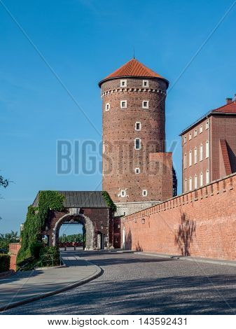 Medieval Gothic Sandomierska Tower entrance gate and defensive wall royal Wawel Castle in Krakow (Cracow) Poland
