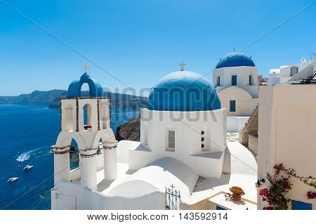 White and blue Santorini - view of caldera with domes - Greece