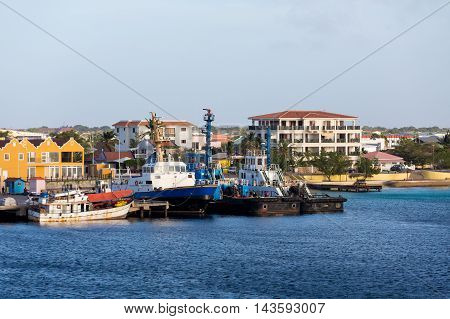 Old boats docked on the coast of Curacao
