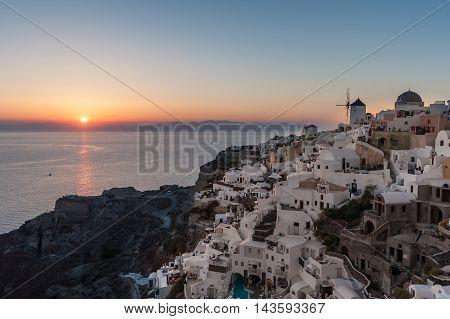 Sunset over Oia village in Santorini - Greece