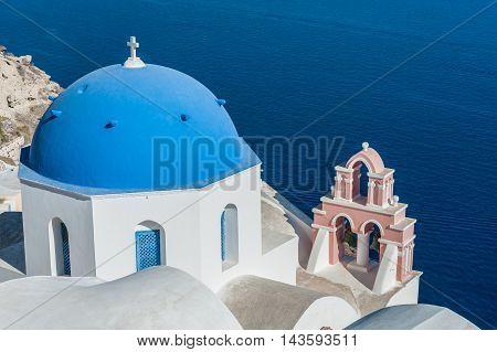 Orthodox church with blue dome over the sea in Santorini - Greece
