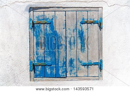 Grunge blue and white window on a white wall