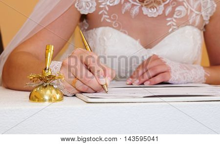 Bridal signature in document in the wedding day