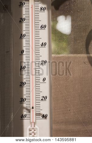 Large White Thermometer Showing 32 Degree Heat, With Background Mosquito Window Protection Asia.