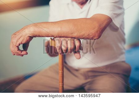Hand of a senior man holding a stick