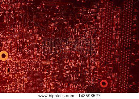 full frame red illuminated printed circuit board closeup