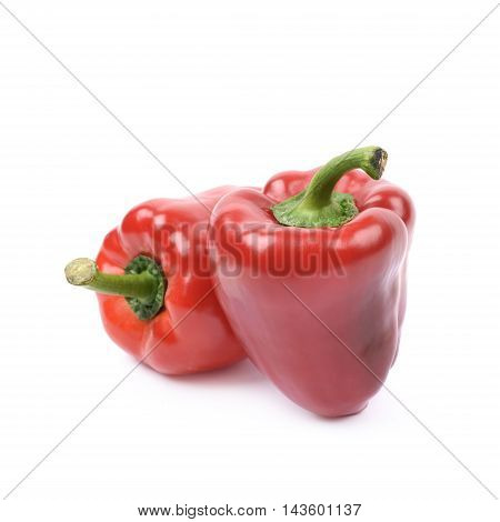 Ripe red bell peppers isolated over the white background