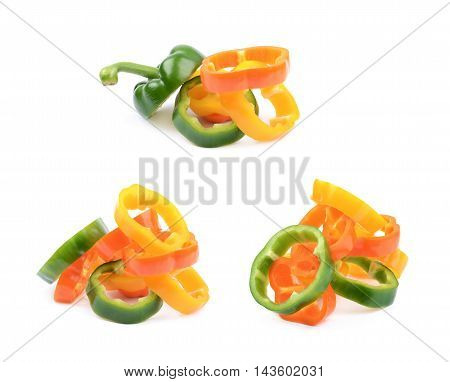 Colorful pile of green, orange, yellow bell pepper slices isolated over the white background, set of three different foreshortenings