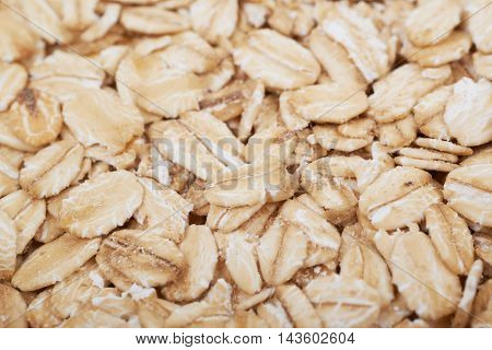 Surface coated with oatmeal flakes as a backdrop texture composition