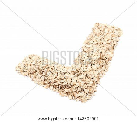 Yes tick shape made of oatmeal flakes isolated over the white background