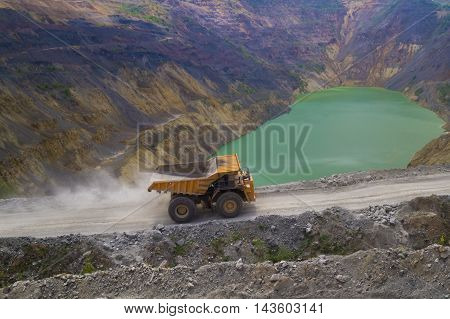 Yellow dump truck on coper surface mining Bor Serbia