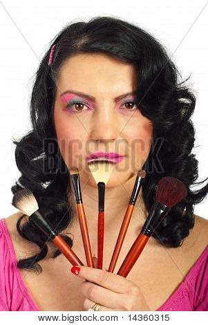 Beauty Woman Holding Brushes Set