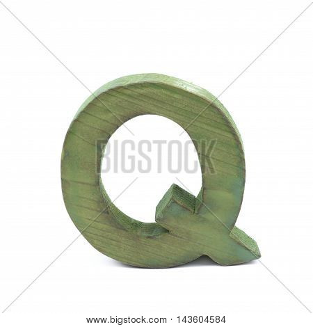 Single sawn wooden letter Q symbol coated with paint isolated over the white background