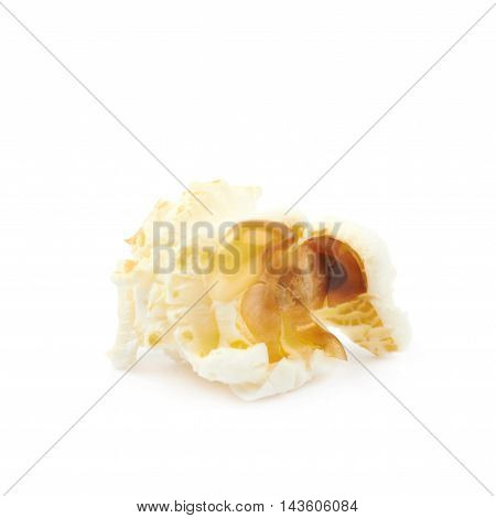 Cooked popcorn flake isolated over the white background