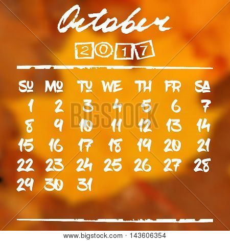 Calendar design grid in hand written style with white lettering and dates of autumn month October 2017 on natural blurred background. Blurry orange leaf of maple. Vector illustration