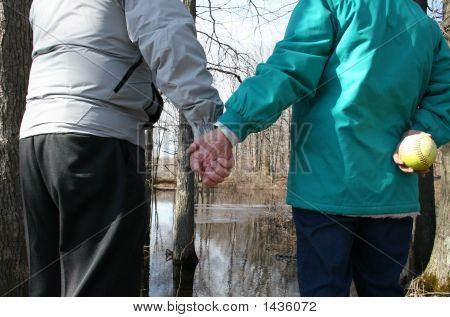 Seniors Holding Hands While Enjoying Nature