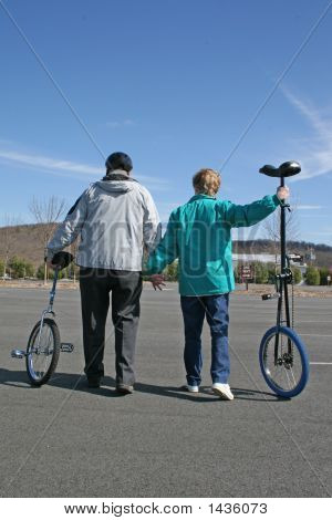 Senior Couple About To Go For Unicycle Ride