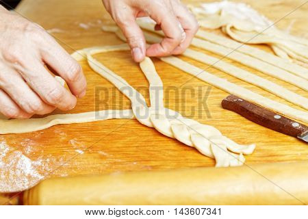Cook Hands Pigtail Braid Of Dough
