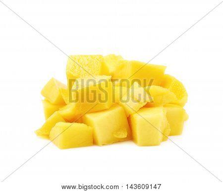Pile of yellow mango fruit cube bits isolated over the white background