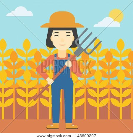 An asian female farmer holding a pitchfork. Smiling Farmer standing on the background of wheat field. Vector flat design illustration. Square layout.