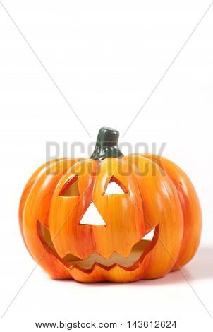 Pumpkin for Halloween with orange leaves isolated on white