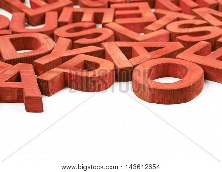 Surface coated with the multiple red painted wooden block letters isolated over the white background as a copyspace abstract backrop composition