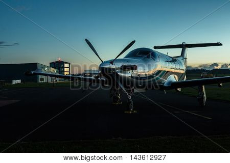 PRIBRAM AIRPORT, CZE - AUGUST 21 2016: Single-engined business airplane on runway after sunset