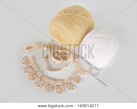 Handmade crochet lace with ball of yarn