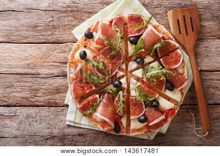 Delicious Pizza With Figs, Ham, Arugula And Cheese Macro. Horizontal Top View