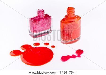 spilled nail polish isolated on white background
