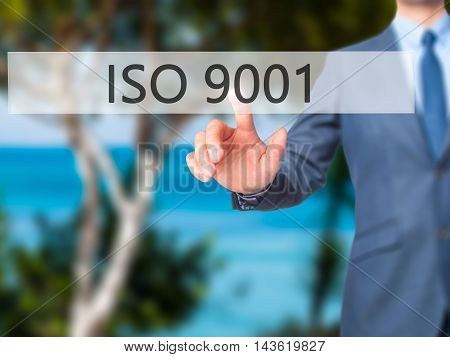 Iso 9001 - Businessman Hand Pressing Button On Touch Screen Interface.