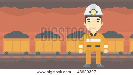 An asian confident coal miner. Male miner in hardhat with torch. Miner standing on the background of mining tunnel with cart full of coal. Vector flat design illustration. Horizontal layout.