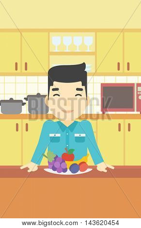 An asian man standing in front of table full of fresh fruits in the kitchen. Man with plate full of fruits. Vector flat design illustration. Vertical layout.