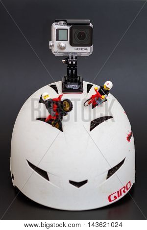 Orvieto Italy - January 17th 2015: . Gopro Hero4 on helmet with lego minifigures cyclist and pilot of motorbike. GoPro is the company that makes the Hero the most popular action cam